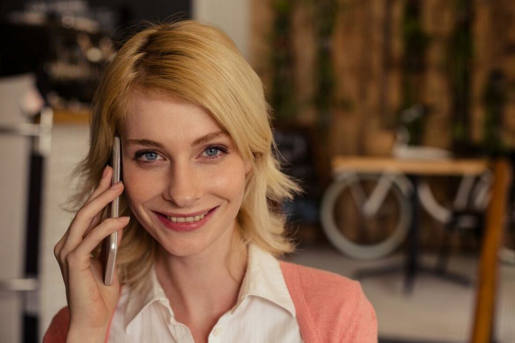 A lovely woman calling and smiling
